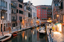 Colourful Venice Canal With Bridge And Boat