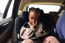 Family Time - A Little Girl On The Backseat In The Car