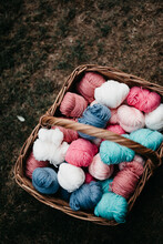Balls Of Wool In A Rotan Basket Outdoors