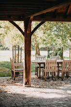 Wooden Garden Table With Chairs In An Autumn Landscape