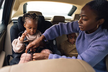 A Family In The Car