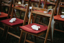 Wooden Folding Chairs Outdoors With Umbrellas Attached