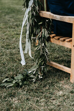 Eucalyptus Decoration On A Wooden Bench For Wedding Ceremony