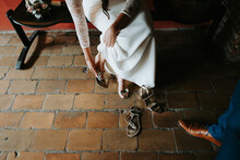 Bride Switching From High Heels To Sandals