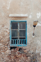 Window In The Old Wall With A Lamp From The Right Side