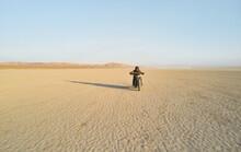 Man Riding Motorcycle In Desert