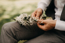 Groom Fixing A Flower Crown Made Of Gypsophila Flowers