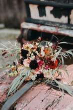 Romantic Bohemian Wedding Bouquet With Red, Pink And Orange Tones