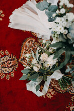 Wedding Bouquet In Church On A Red Carpet