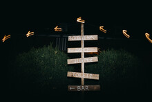 Wooden Sign On A Wedding Outdoors By Night