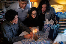 Hanukkah: Family Gathers To Light Candles On First Night Of Holi