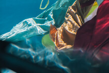 An Abstract View Of Colored Sheets Flowing Underwater
