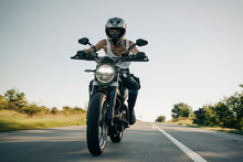 Motorcyclist Riding On The Open Road