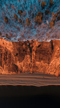 The Edge Of The Forest - Sandy Cliff Lit By Sunset