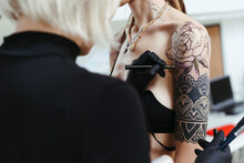 Female Artist In The Process Of Making A Tattoo.