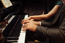 Man And Woman, Playing A Piano