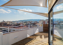Sunny Empty Terrace With A Sunshade. View To The Hill And The City. Barcelona, Spain