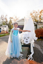Smiling Girl In Costume With Skull Candy Slide