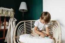 A Little Boy In A Cozy Room.