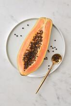 Half Of Fresh Organic Exotic Papaya Fruit On A Plate.