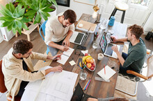 Group Of Designers Working In An Office
