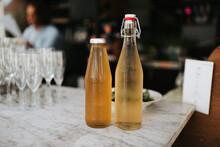 Two Bottles Of Homemade Lemonade