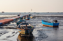 Landscape Of The Gulf Of Thailand Before The High Tide Surrounded By Old Boats