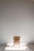 Small Rotan Chair In The Sun