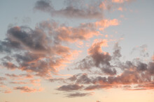 Pink Clouds In The Sky At Sunset