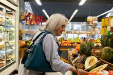 Mature Grey Hair Woman Buying Groceries At Fruit Store
