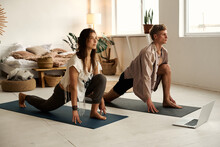 Fitness, Sport, Friendship And Lifestyle Concept - Couple Making Yoga Exercises