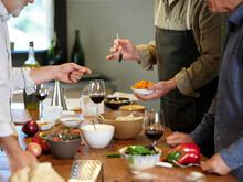 Men Tasting Prepared Food