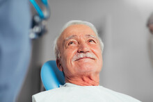 An Old Man At A Dental Examination