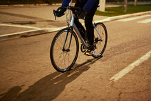 Young Man Cycling In The Evening