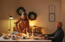 Senior Husband And Wife Having Christmas Dinner At Home
