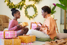 Mother And Daughter Sharing Christmas Gifts