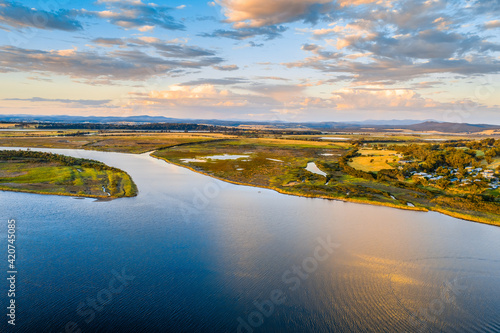 Fototapeta Sunset over river and agricultural land in Victoria, Australia obraz