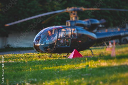Canvas Civil black helicopter getting ready to fly, commercial charter private copter a