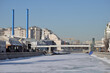 Panorama of Bolotnaya embankment, Yakimanskaya embankment and Drainage (Vodootvodny) Canal during ice drift in early spring on sunny day, Moscow, Russia