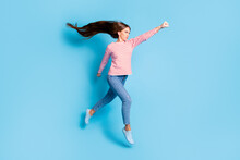 Full Length Body Size Photo Serious Powerful Girl Jumping Imagine Flying Super Woman Isolated Vivid Blue Color Background
