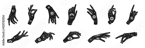 Vector set of woman hands with mystical magic symbols-eyes, sun, phrases of moon, stars, jewels Fotobehang