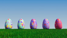 Easter Eggs On A Grass Lawn, With A Clear Blue Sky. Beautiful Purple, Red And Aqua Eggs With Circle And Ring Patterns. 3D Render