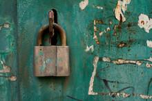 Old Rusty Padlock Close-up On An Old Metal Door