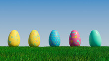 Easter Eggs On A Grass Lawn, With A Clear Blue Sky. Beautiful Blue, Yellow And Pink Eggs With Triangle And Floral Patterns. 3D Render