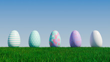 Easter Eggs On A Grass Lawn, With A Clear Blue Sky. Beautiful Purple, And Aqua Eggs With Spotted, Floral And Striped Patterns. 3D Render