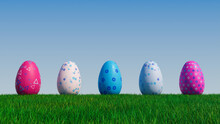 Easter Eggs On A Grass Lawn, With A Clear Blue Sky. Beautiful Pink, And Blue Eggs With Triangle And Floral Patterns. 3D Render