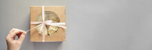 Paper Box With Cream Cupcake. Birthday Sweet Bakery. Cookies Four Pack. Yummy Buttercream Dessert. Wedding Party Food. Grey Background. Holiday Recipe. Hand Holding