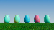 Easter Eggs On A Grass Lawn, With A Clear Blue Sky. Beautiful Blue, Yellow And Pink Eggs With Striped And Spotted Patterns. 3D Render