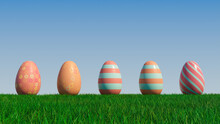 Easter Eggs On A Grass Lawn, With A Clear Blue Sky. Beautiful Orange And Red Eggs With Floral, And Striped Patterns. 3D Render
