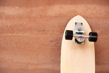 Surf Skate Board On Wall Background